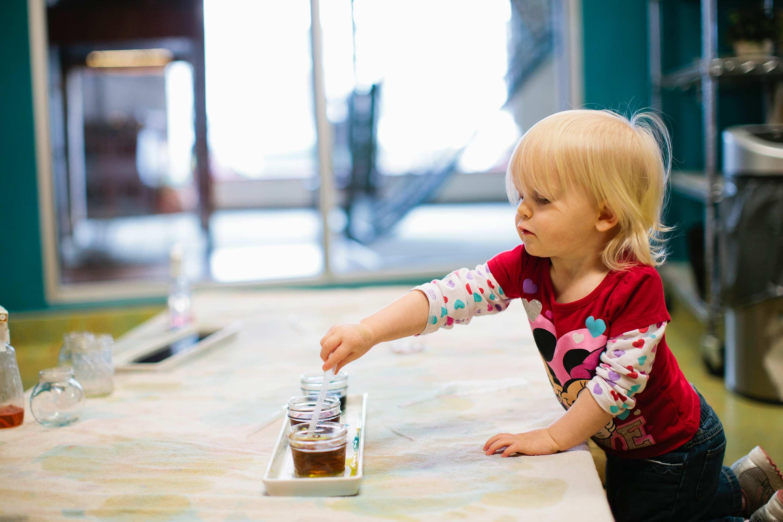 child doing art