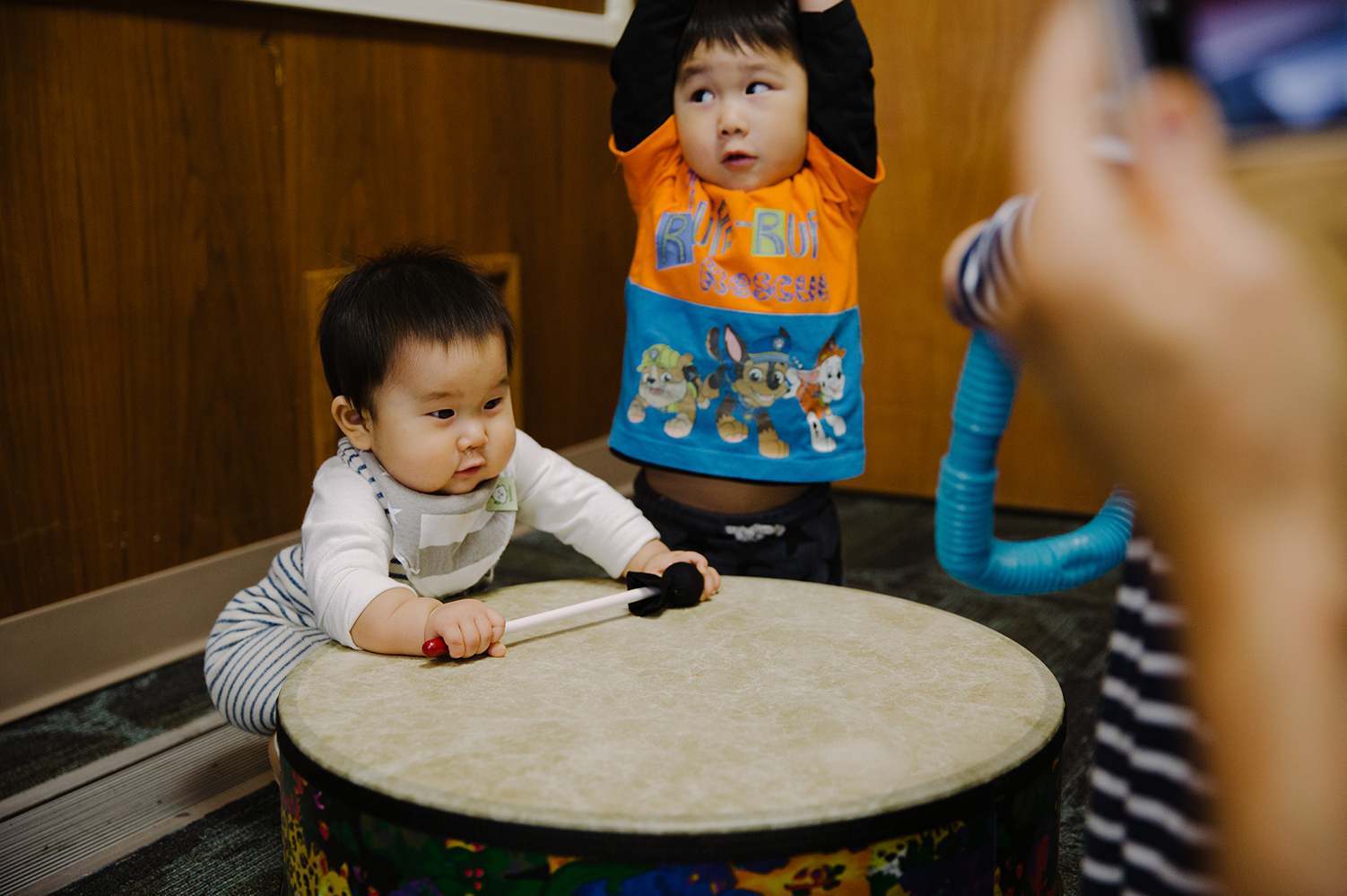 child playing with drum
